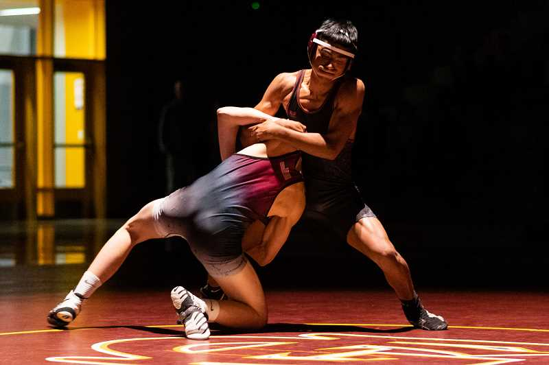 PMG PHOTO: CHRISTOPHER OERTELL - Forest Grove's Jose Diaz wrestled Sherwood's Logan Swanson in the 132 weight class during a dual meet at Forest Grove High School in Forest Grove, Ore., on Thursday, Jan. 23, 2020.