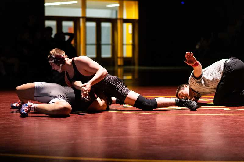 PMG PHOTO: CHRISTOPHER OERTELL - Forest Grove's Gavin Rice wrestled Sherwood's Ashton Sarono in the 195 weight class during a dual meet at Forest Grove High School in on Thursday, Jan. 23.