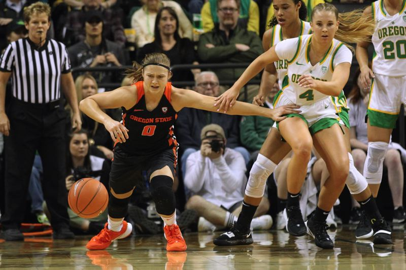 PMG PHOTO: JAIME VALDEZ - Oregon State's Mikayla Pivec (left) goes after a loose ball during a game last weekend against Oregon.