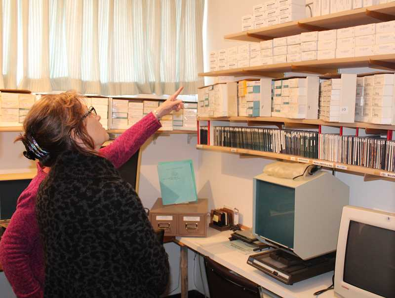 SUSAN MATHENY/MADRAS PIONEER - Amidst the collection in the Family Finders library are years' worth of Madras Pioneer newspapers on microfilm. Above, Dorthy Burgess shows library director Jane Ellen Innes the group's microfilm archives.