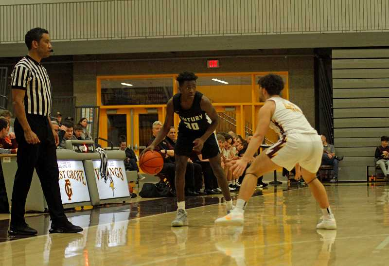 PMG PHOTO: WADE EVANSON - Century's Edidem Essien surveys the landscape during the Jaguars' game against Forest Grove Tuesday night, Jan. 28, at Forest Grove High School.