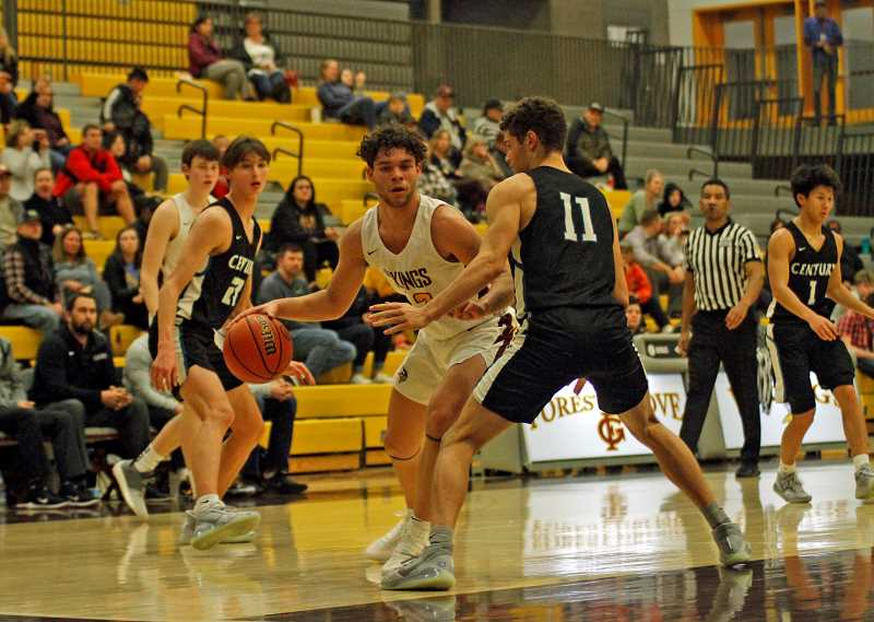 PMG PHOTO: WADE EVANSON - Forest Grove's James Irvine works down low against Century's Chance Sparks during the Vikings' game against the Jaguars Tuesday night, Jan. 28, at Forest Grove High School.