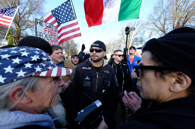 COURTESY PHOTO: ALEX MILAN TRACY - In December 2017, a week after an undocumented Mexican resident of San Francisco was acquitted of the murder of Kate Seinle, Patriot Prayer leader Joey Gibson led a protest in Portland. As is often the case with Gibson's events, it drew activists from both political extremes, including Luis Enrique Marquez (right) a prominent anti-fascist protester, and Kerry Hudson (left), who can be found at many Patriot Prayer rallies.