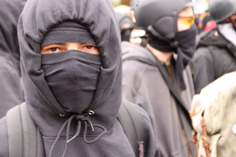 PMG FILE PHOTO - Members of Antifa wear black masks during a downtown Portland protest. An Oregon legislator has proposed a bill to increase penalties for people caught rioting in masks.