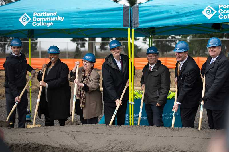 PMG PHOTO: ANNA DEL SAVIO - Leaders on the Portland Community College Oregon Manufacturing Innovation Center project in Scappoose participate in a groundbreaking ceremony on Wednesday, Jan. 29. From left to right: PCC OMIC Training Center Director Andrew Lattanner, PCC Board Member Tiffani Penson, State Sen. Betsy Johnson (D-Scappoose), PCC Board Member Jim Harper, PCC President Mark Mitsui, OMIC Research & Development Executive Director Craig Campbell, and Scappoose Mayor Scott Burge.
