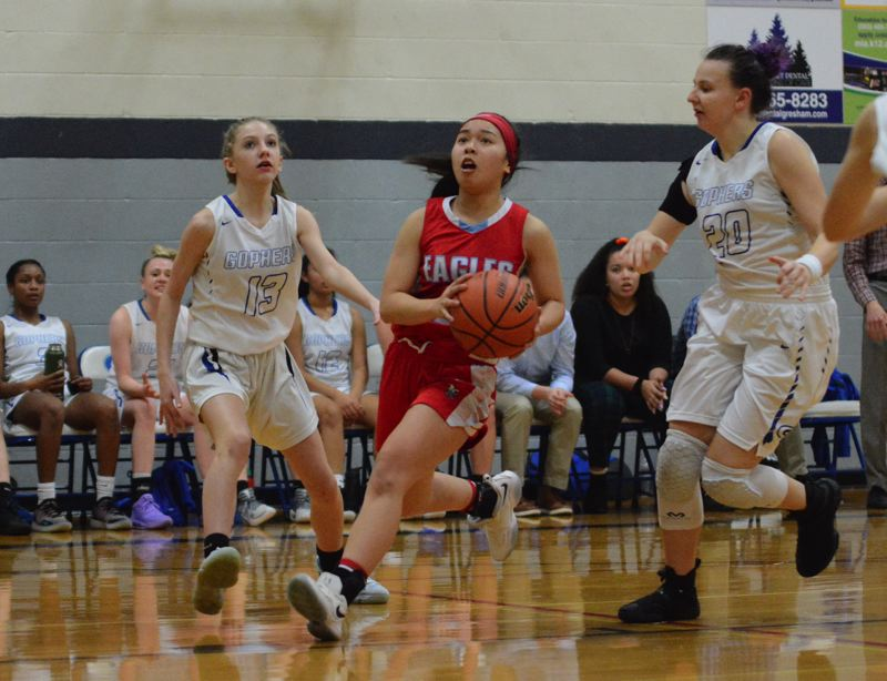 PMG PHOTO: DAVID BALL - Centennials Quynh Vu drives to the basket for two points during the Eagles 30-18 win at Gresham on Tuesday.