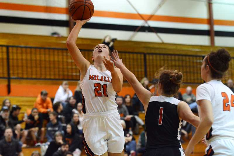 PMG PHOTO: DEREK WILEY - Molalla junior Kaityn Curry scored 16 points in the second half to lead the Indians past Corbett Tuesday.