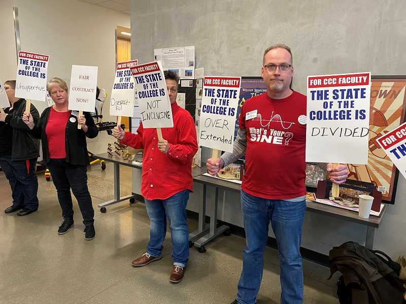PMG PHOTO: KRISTEN WOHLERS - Clackamas Community College staff and faculty line the entrance to the college's Harmony West building on Jan. 23.