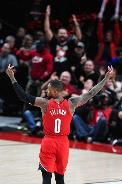 PMG PHOTO: CHRISTOPHER OERTELL - Damian Lillard's first NBA triple-double (36 points, 11 assists and 10 rebounds) leads the Trail Blazers to a 125-112 victory at home Wednesday over the Houston Rockets.