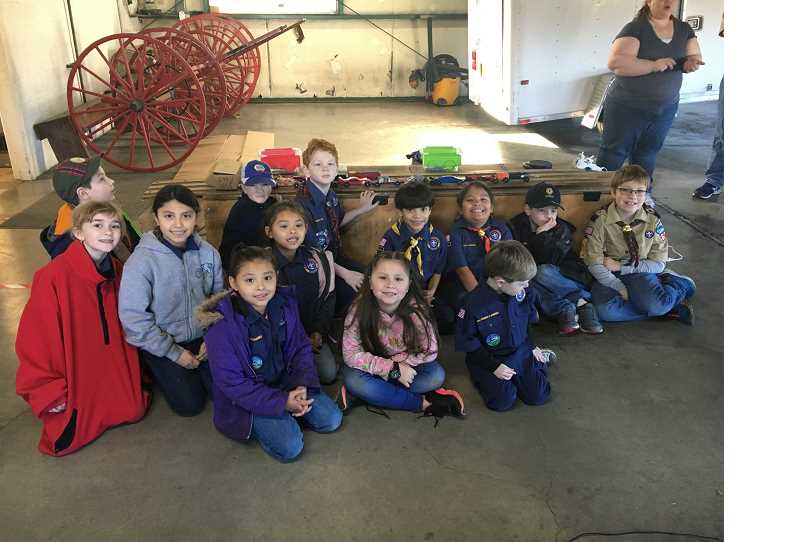 COURTESY OF JAMES ALDRITSH - Cub Scout Pack No. 569 takes a group photo following the local Pinewood Derby race at Broadacres Fire Station.
