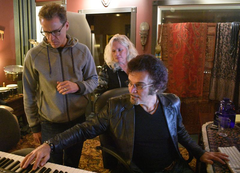 PMG PHOTO: SHANNON O. WELLS - Gino Vannelli, right, demonstrates a piano part for David Goldblatt and Julie LaMeng, while recording a Christmas-oriented album last month in Vannellis Gresham-area studio.
