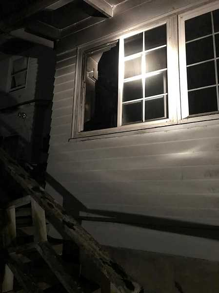 CRFR PHOTO - A fire broke out at Scappoose Historical Society President Karen Holmbergs home in Rainier on Wednesday, Feb. 22. Holmberg escaped through a window. Firefighters were able to contain the blaze to one room.