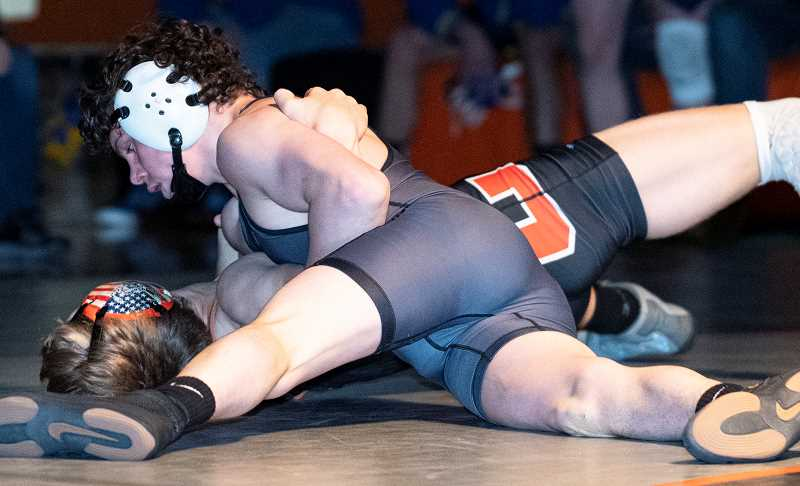 LON AUSTIN/CENTRAL OREGONIAN - Hunter Mode earns a fall over Gabe Wilson of Culver early in the second round of their 145-pound match. Mode led 18-8 at the end of one period after picking up nine takedowns in the first round. The Cowboys went on to win the dual, which took place on the Culver mats, 70-4.