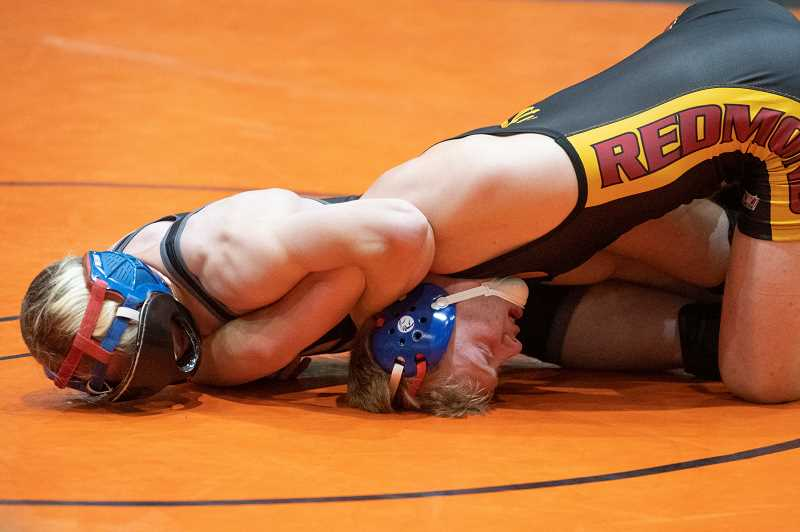 PMG PHOTO: LON AUSTIN - Scappoose star wrestler Trevor Jackson is leading and winning for the Indians this year.
