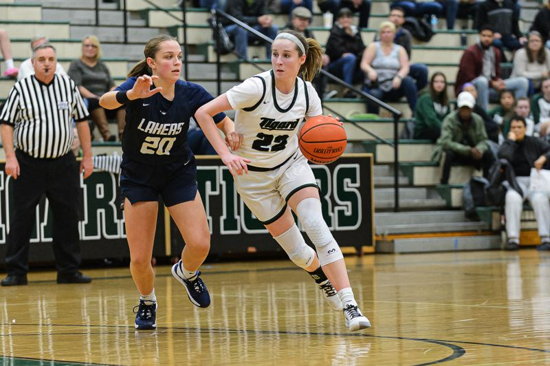 PHOTO COURTESY: CHRISTOPHER GERMANO - Tigard High School senior Delaney Leavitt (right), shown here during the Tigers' home win over Lake Oswego on Tuesday, and her Tiger teammates will host rival Tualatin in a Three Rivers League contest tonight.
