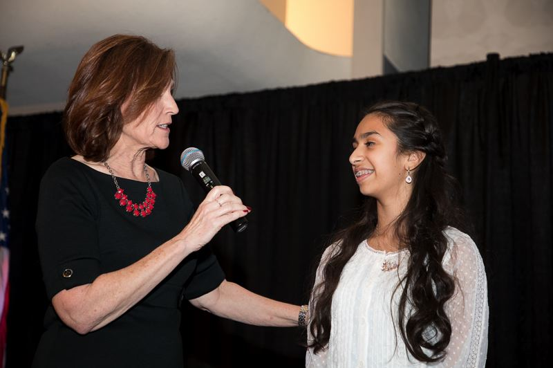 COURTESY PHOTO: BILL BARRY/ROYAL ROSARIANS - Debra Gil, of KPTV, interviews Beaverton fifth-grader Raaga Mandala during her award as a 2019 Newsmaker. Mandala was selected as Oregon's 'Kid Governor' last year and is working to support the state's homeless residents.