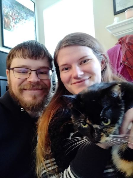 COURTESY PHOTO - Paulo Dias and Courtney Simpson pose for a photo with Mrs. Bigglesworth, whom they adopted from the Cat Adoption Team in Sherwood on Nov. 17, 2019.