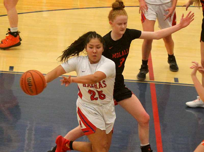 STEELE HAUGEN - Madras' Jiana Smith-Francis was the leading scorer for the Buffalos, but Madras fell short to Molalla 50-41 Jan. 31.