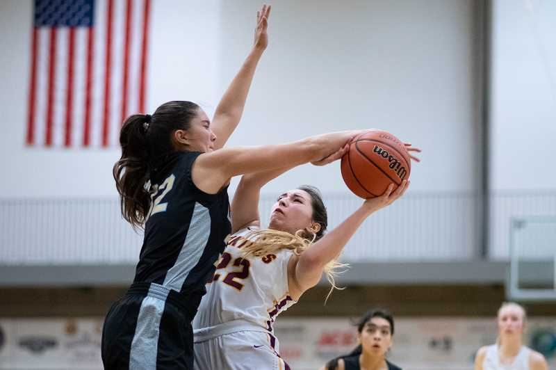 PMG PHOTO: CHRISTOPHER OERTELL - Liberty's Alyssa Chronister (32) and Forest Grove's Kayleen Dominguez (22) during a girls basketball game at Forest Grove High School in Forest Grove, Ore., on Friday, Jan. 31, 2020.