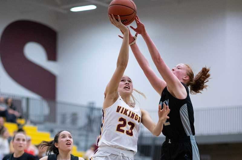 PMG PHOTO: CHRISTOPHER OERTELL - Forest Grove's Amanda Rebsom (23) and Liberty's Breeze Bartle (12) during a girls basketball game at Forest Grove High School in Forest Grove, Ore., on Friday, Jan. 31, 2020.