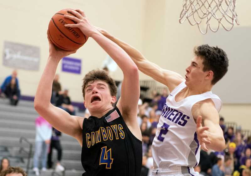LON AUSTIN/CENTRAL OREGONIAN - Caleb Arnold goes to the hoop for two of his 10 points as the Crook County Cowboys rolled past the Ridgeview Ravens 64-37 Friday night in Intermountain Conference basketball action.