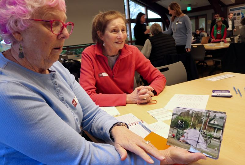 PMG PHOTO: ZANE SPARLING - Sue, a Portland resident for the last six decades, brought photos of Portland area camps to a community forum on homelessness.
