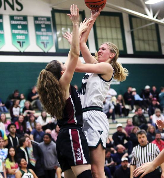 PMG PHOTO: DAN BROOD - Tigard High School sophomore post Sarah Lamet (right) shoots over Tualatin junior Natalie Lathrop during Friday's Three Rivers League contest.