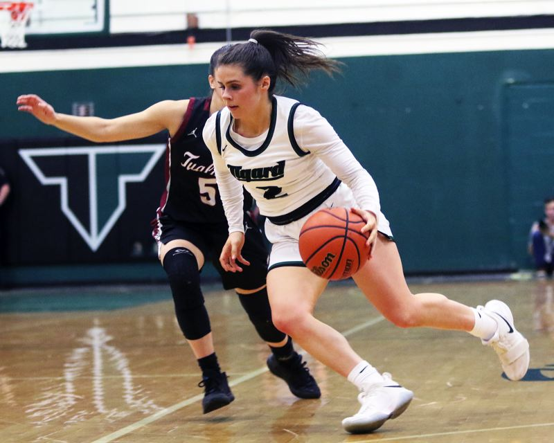 PMG PHOTO: DAN BROOD - Tigard High School senior guard Kennedy Brown looks to drive to the basket during the Tigers' Three Rivers League game with Tualatin on Friday.