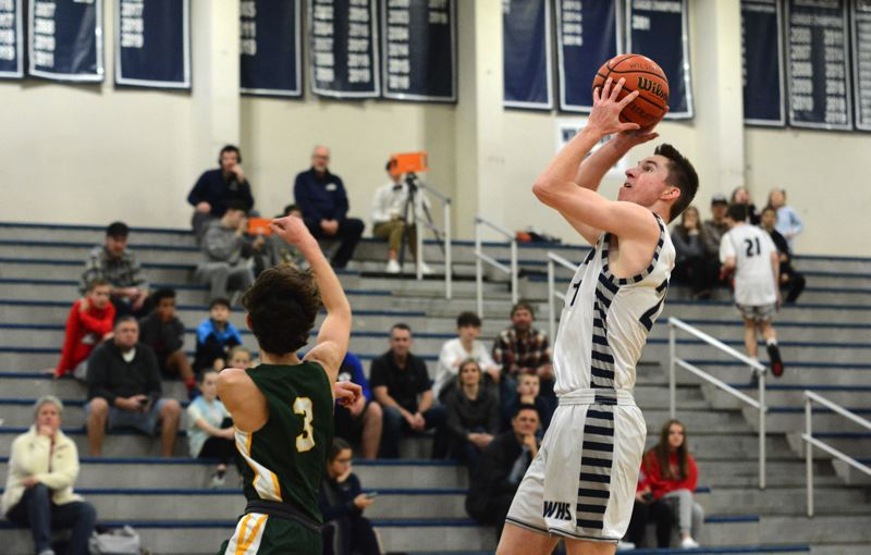 PMG PHOTO: DEREK WILEY - Wilsonville senior Andrew Classen scored eight points in the first half Friday against Putnam.