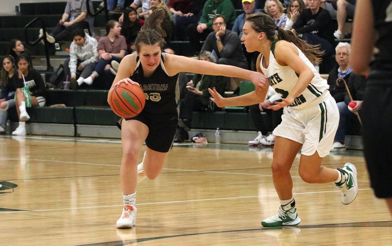 PMG PHOTO: JIM BESEDA - Gladstone's Hanne Hopkins looks for room to drive around North Marion's Mya Hammack during the second half of Friday's Tri-Valley Conference girls basketball game at North Marion in Aurora.