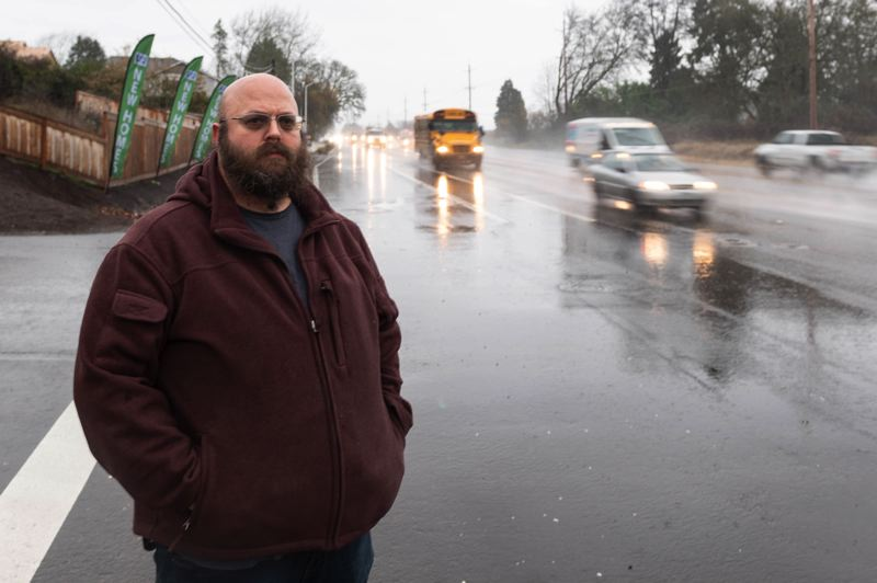 PMG PHOTO: CHRISTOPHER OERTELL - Michael Jerome stands on the corner of Highway 8 and Northwest 341st Avenue where his girlfriend, Leslie Schmadeke, was recently hit and killed while trying to cross the highway.