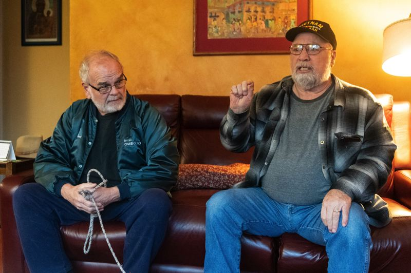 PMG PHOTO: CHRISTOPHER OERTELL - George Gunn and Dennis Eubanks, residents of Northwest 341st Avenue near Cornelius, speak about the safety changes they would like to see along Highway 8 between Hillsboro and Cornelius on Wednesday, Jan. 29.