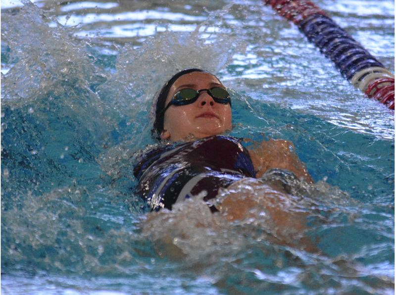 PMG PHOTO: DAVID BALL - Centennial rookie Elle Moir churns the water in the opening leg of the Eagles win in the 200-yard medley relay Thursday against Reynolds.