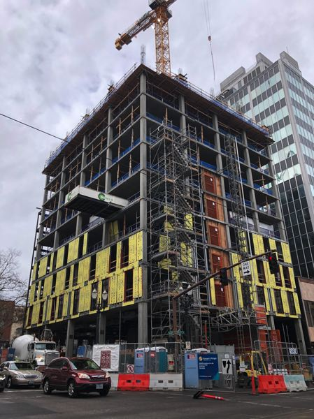 PMG PHOTO: STEPHANIE BASALYGA - The exterior of the Moxy Hotel, on the corner of Southwest 10th Avenue and Alder Street, will feature building will feature brick, aluminum composite panels, and aluminum sliding doors and storefronts.