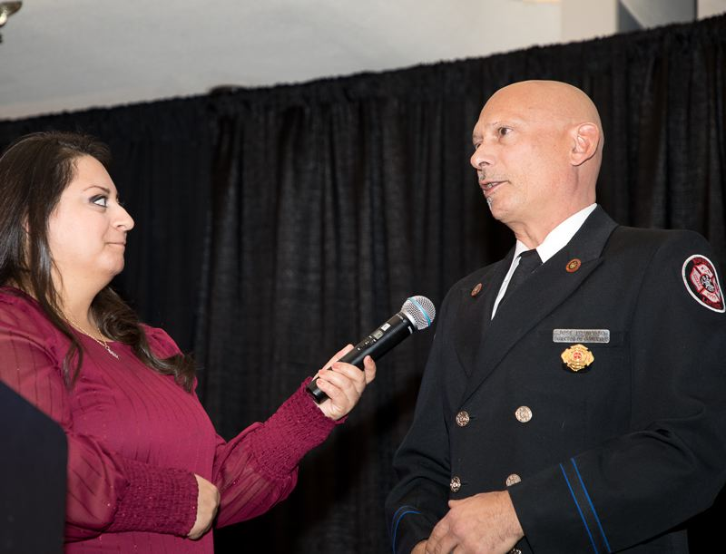 COURTESY PHOTO: BILL BARRY/ROYAL ROSARIANS - Carmen Montes, an anchor for KUNP Univision, introduced Portland firefighter Jose Troncoso, who was honored on Jan. 30 at the Royal Rosarians Newsmakers of the Year event. Troncoso is the founder of Bomberos Latinos, which has helped train firefighters in more than a dozen Spanish-speaking countries.