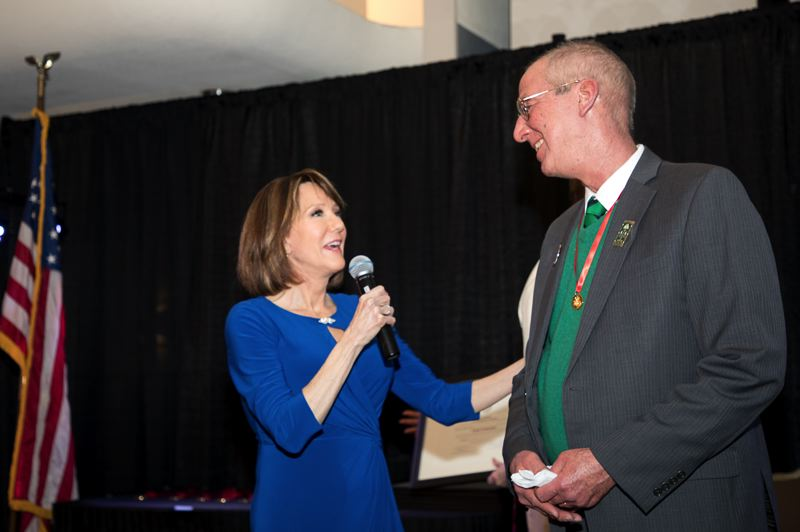 COURTESY PHOTO: BILL BARRY/ROYAL ROSARIANS - KGW anchor Laural Porter interviews Steve Slavik, who started the Alameda-Irvington neighborhood St. Patricks Day Parade 30 years ago. Slavik was one of 10 resdients of the metro area honored on Jan. 30 as a Royal Rosarian 2019 Newsmaker of the Year.