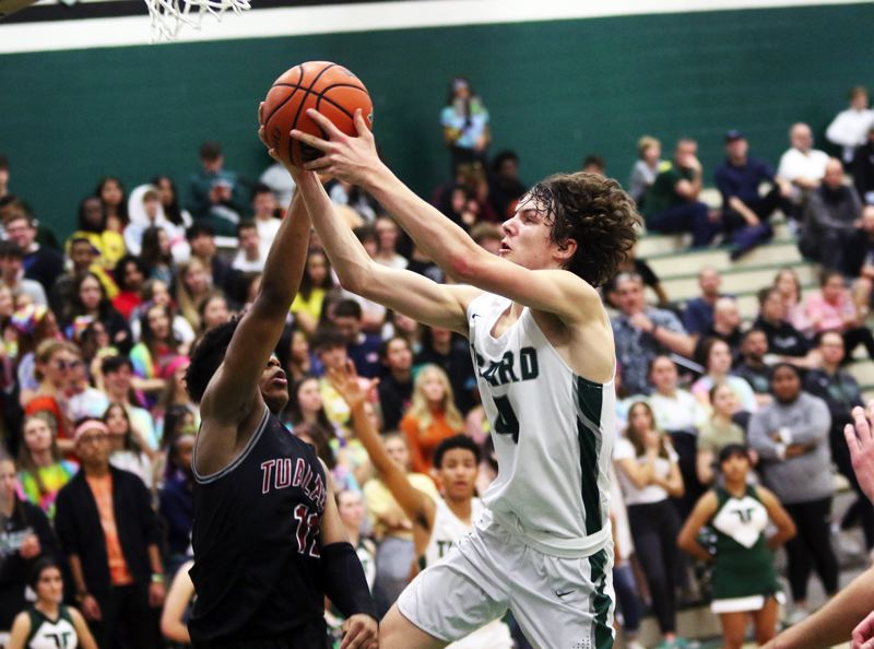 PMG PHOTO: DAN BROOD - Tigard High school junior Brett Moss goes up to the basket during the Tigers' Three Rivers League contest with Tualatin on Friday.