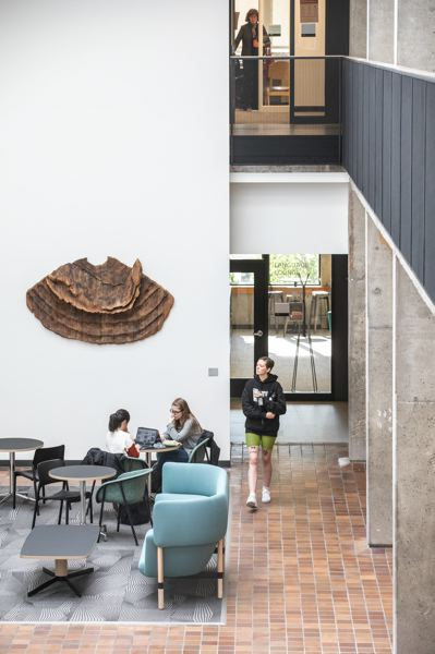 PMG FILE PHOTO - Students enjoy a new common area in the newly-coined Fariborz Maseeh Hall at PSU. The university is expanding eligibility for its free tuition program for Oregon residents.