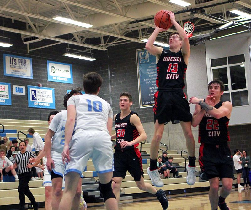 PMG PHOTO: MILES VANCE - Oregon City senior guard Lucas Hanson used his pull-up jumpshot to great effect on Friday, Jan. 31, helping the Pioneers race away from Lakeridge 66-38.