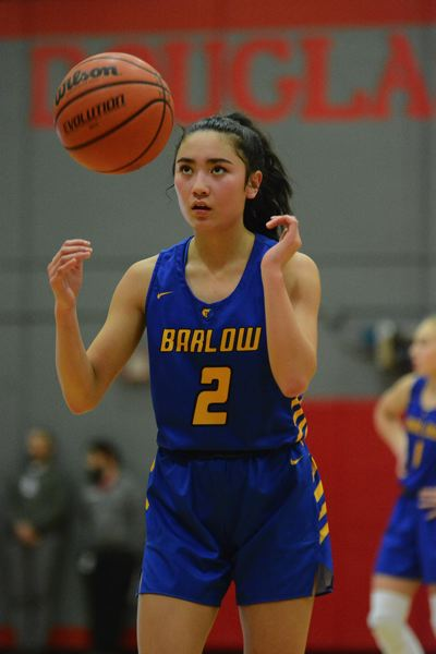 PMG PHOTO: DAVID BALL - Barlows Melanie Hiu sank a 3-pointer to help the Bruins to a 26-point halftime lead in their win at Sandy on Friday night.