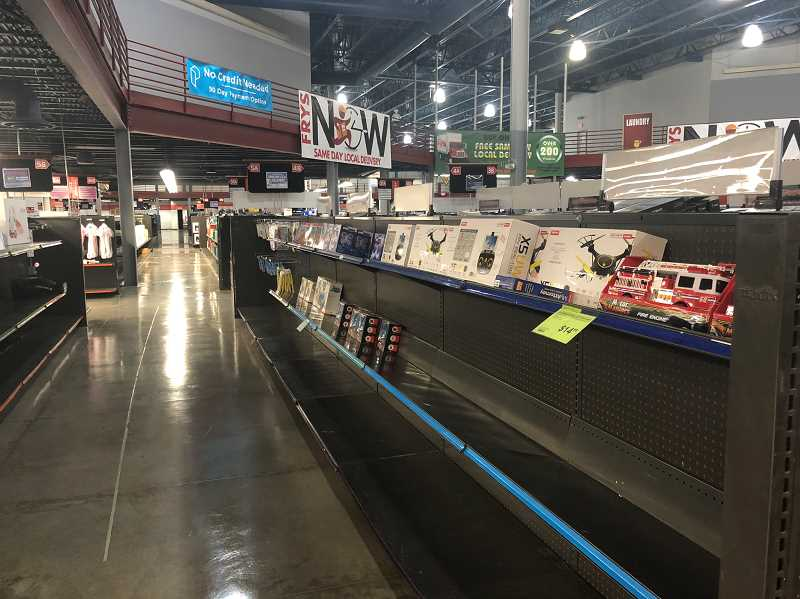 PMG PHOTO: COREY BUCHANAN - Many of the aisles in Fry's Electronics in Wilsonville are emptying.