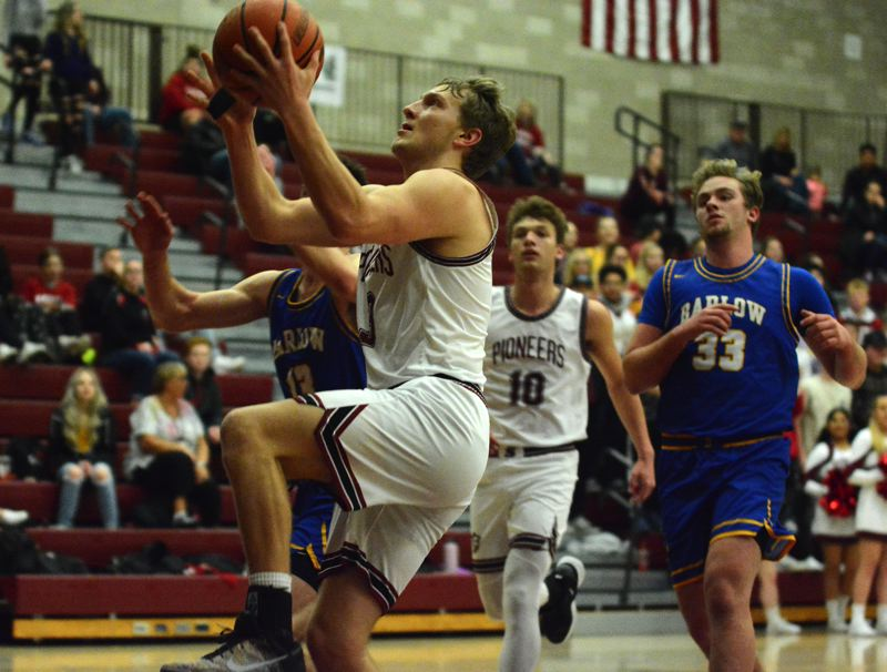 PMG PHOTO: DAVID BALL - Sandys Colby Carson goes to the basket for the teams first points in Fridays 75-58 home loss to Barlow.