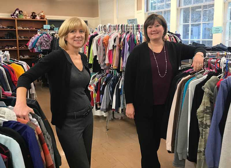 COURTESY PHOTO - Mary Ellen Winterhalter (left) and Julie Baumann welcome Oregon City homeless students to the school districts clothes closet at Barclay School.