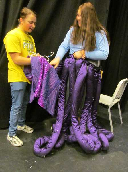 PHOTO BY ELLEN SPITALERI - Alex Mehigan and Maddy Szidon discuss adding tentacles to one of the costumes for Ursula in 'The Little Mermaid.'