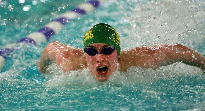 PMG PHOTO: MILES VANCE - West Linn junior Nathan Rumsey speeds to victory in the 100-yard butterfly during his team's 98-70 win over Tualatin at Tualatin Aquatic Center on Thursday, Jan. 30.