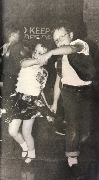CENTRAL OREGONIAN - FEB. 2, 1995: Care to Dance? Kalysa Bond, 5, and her brother, Logan, 7, dance it up 1950s style during the community dance Saturday night, which raised $1,043 to benefit the local DARE program.