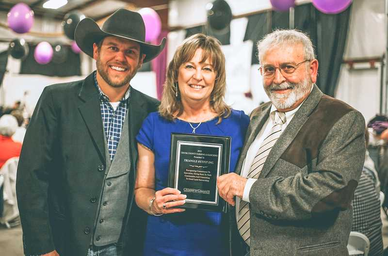 PHOTO SUBMITTED BY KIM DANIELS - Triangle Outfit Inc. personnel receive the Crook County Farming and Ranching award at the 2019 Chamber banquet. The Chamber is currently seeking nominations for this award and many others.