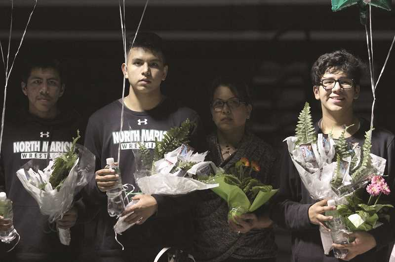 PMG PHOTO: PHIL HAWKINS - North Marion seniors Ronaldo Gonzalez, Roberto Ibarra and Bryan Bravo Gonzalez were recognized in the Huskies final home dual on Thursday against the Stayton Eagles.