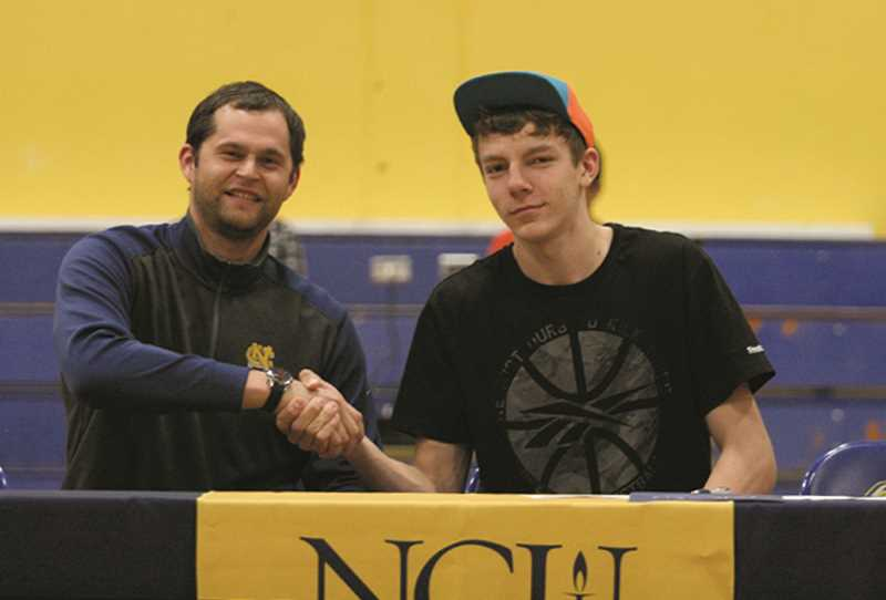 PMG FILE PHOTO: PHIL HAWKINS - Kelley signed with then-head coach Luke Jackson at Northwest Christian University in 2015. After a medical redshirt season, Kelley averaged 5.6 blocks for the Beacons, setting the single-game school record with 10 swats.