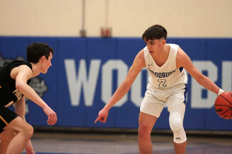 PMG PHOTO: PHIL HAWKINS - Woodburn junior Tomas Veliz led the Bulldogs with 14 points, nearly all of which came via four 3-pointers he knocked down throughout the course of the game.